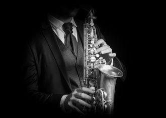 Detail hráče na saxofon